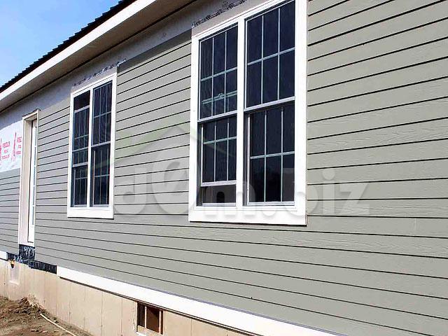 Обшивка дома горизонтальным цементным сайдингом