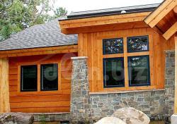 Отделка фасада деревянного дома камнем